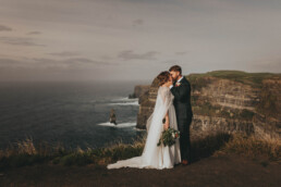 Cliff of Moher Elope in ireland Elopement uai - Fun and Relaxed wedding and elopement photography in Ireland, perfect for adventurous and outdoorsy couples